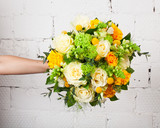 Creative bouquet of flowers at arm's length, beautiful flowers as a gift beloved. - 138681476