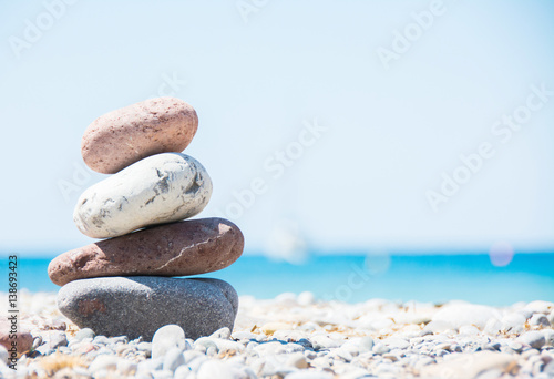 Foto op Canvas Zen Relaxing in summer concept. Stones on the beach with boat on background.