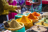 Colorful spices powders and herbs in traditional street market in Delhi. India.