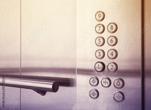 Poster Buttons and handrail in  modern elevator business centers