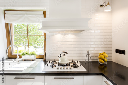 White kitchen with black countertop