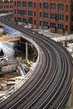 a curved section of the Chicago Elevated Train tracks with construction on a new building happening near by