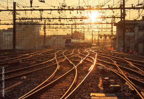 A train on the railroad tracks at Perrache station in Lyon (Gare de Lyon-Perrache), France, during sunrise Poster