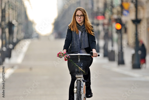 Young woman on a bicycle.