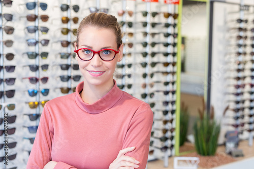 Poster young woman in optician shop