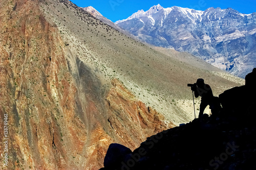 Man photographing mountains in Nepal Poster
