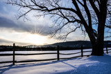 Countryside field in Virginia covered in snow during winter with sunset