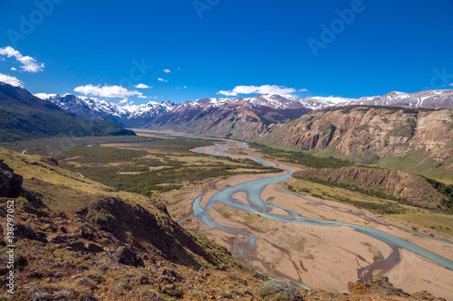 Argentina, Patagonia, El Chalten area. Trekking to the Laguna Capri and Fitz Roy Mountain. Landscape view to the river Rio de las Vueltas valley. Sky with the clouds.