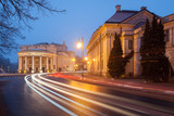 Night cityscape in Kalisz, Greater poland, the theatre building. Smudges of blurred car light.