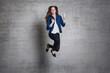 euphoric business woman jump wall