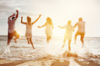 Leinwandbild Motiv Happy friends group people sunset sea
