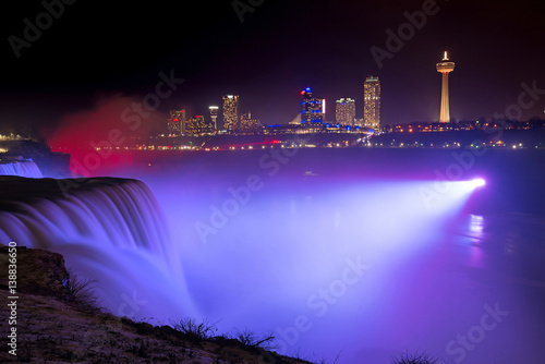 Violet light shining on Niagara Falls  Photo by Michael