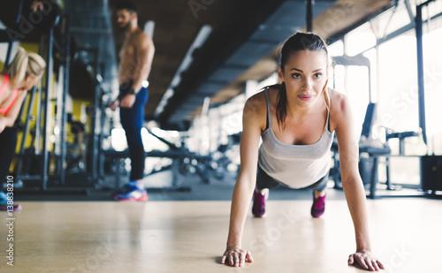 Healthy focused girl doing push ups