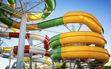 Water park with water colored flights and pools. - 138843680