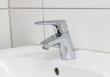 wash basin tap in chrome bathroom