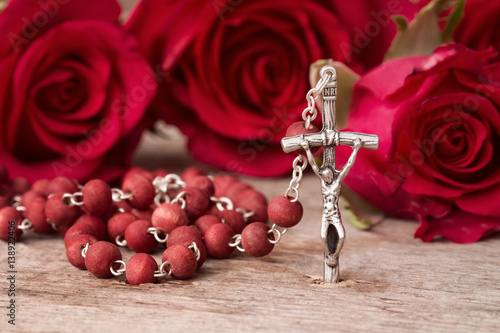 Rosary and roses,religion concept