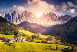 Fototapety Countryside view of the Funes valley St. Magdalena or Santa Maddalena in the National park Puez Odle or Geisler. Dolomites, South Tyrol. Location Bolzano, Italy, Europe. Dramatic scene. Beauty world.