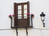 Balconies with flowers pot in Sitges, Spain