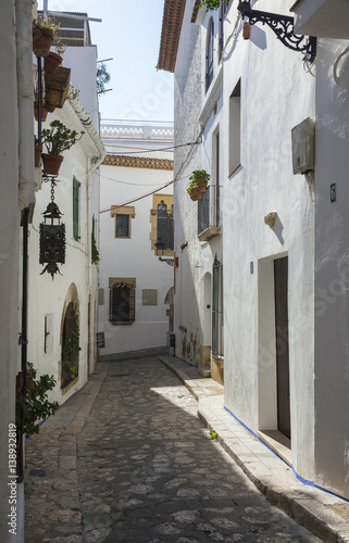 Narrow medieval street in Old Sitges town, Barcelona, Spain