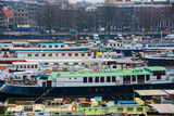 Ships on the canals in Amsterdam. City landscape. Winter season