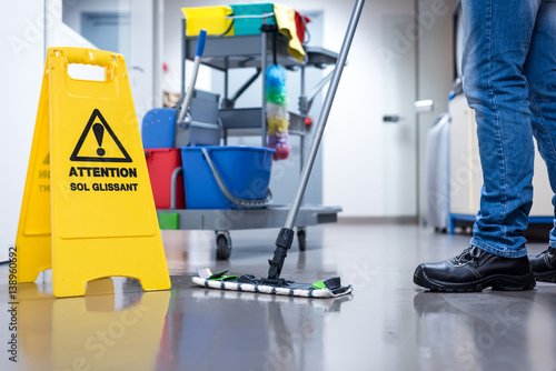 Leinwanddruck Bild Worker janitor Mopping Floor In Office with trolley