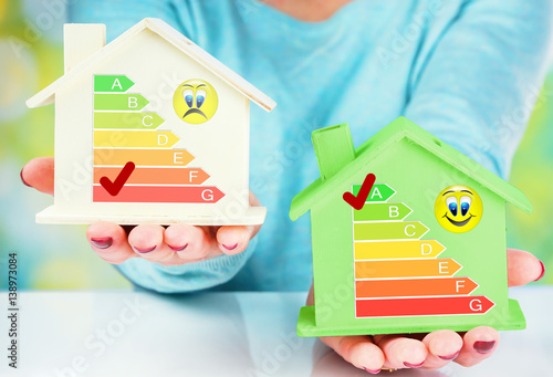 concept comparison between normal house and low consumption house with energy ef Poster