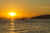 Sunset and traditional thai long boat around seaside, Ao Nang, Krabi province, Thailand