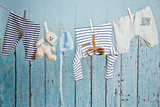 Baby clothes hanging on the clothesline - 138991255