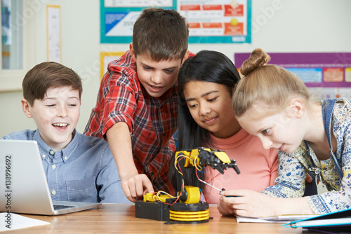 Pupils In Science Lesson Studying Robotics