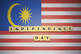 letters with text independence day on the national flag of malaysia.