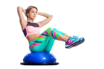 Woman doing exercises on the bosu abdominal muscles. Isolated © Виталий Сова