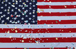 American flag stars and stripes with colorful confetti during th