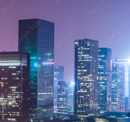 Poster illuminated cityscape at night in Shanghai,China.