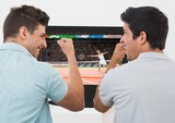 Friends cheering while watching tennis match on television