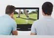 Friends watching golf on television at home