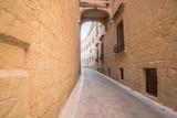 Old street in Rabat, Malta, atmospheric, winding alley.