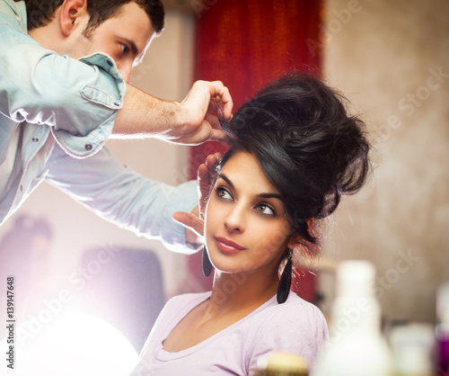 Fotobehang Kapsalon Young black hair woman gets new hairstyle at the hairdresser.Beauty salon.
