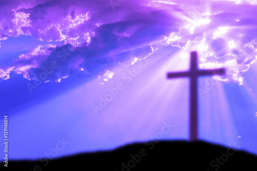 Cross on the Calvary hill with cloudy sky and sun light beams or rays Canvas