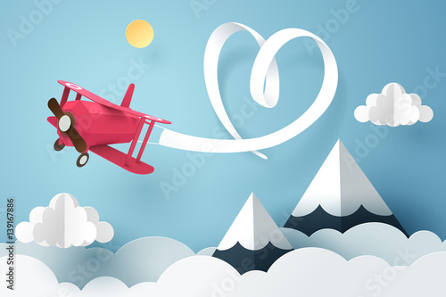 Paper art of ribbon hang with a pink plane flying in the sky, origami and valentines day concept