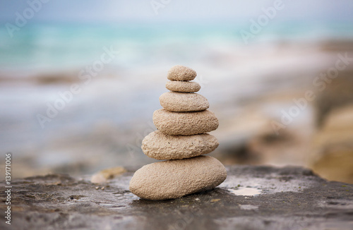 Foto op Plexiglas Stenen in het Zand Zen stones, background ocean for the perfect meditation