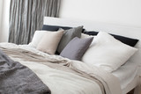 Fototapety Bed with white and grey linens