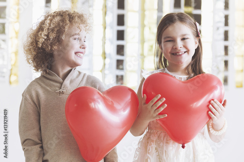 Boy and girl with hearts Poster