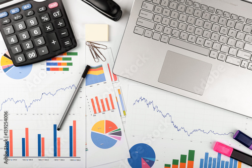 data analysis - workplace with business graphs and charts