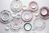 Plates on white table  - 139259426