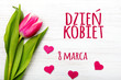 Women's day card with Polish words DZIEŃ KOBIET. Tulip flower small hearts on white wooden background. - 139271229