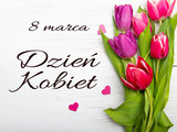 Women's day card with Polish words DZIEŃ KOBIET.Tulip flower and small heart on white wooden background, copy space - 139271209