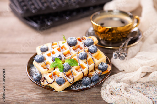 Poster Homemade wafers with berries and coffee on a table