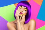 Model in creative image with pop art makeup