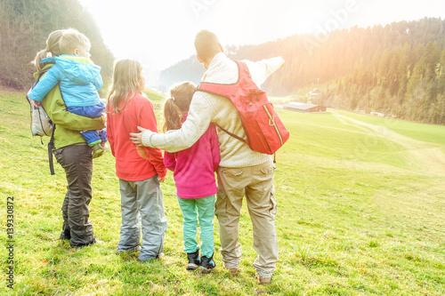Large family having trekking vacation day in switzerland mountains