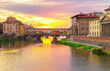 famous bridge Ponte Vecchio over Arno river at sunset, Florence, Italy